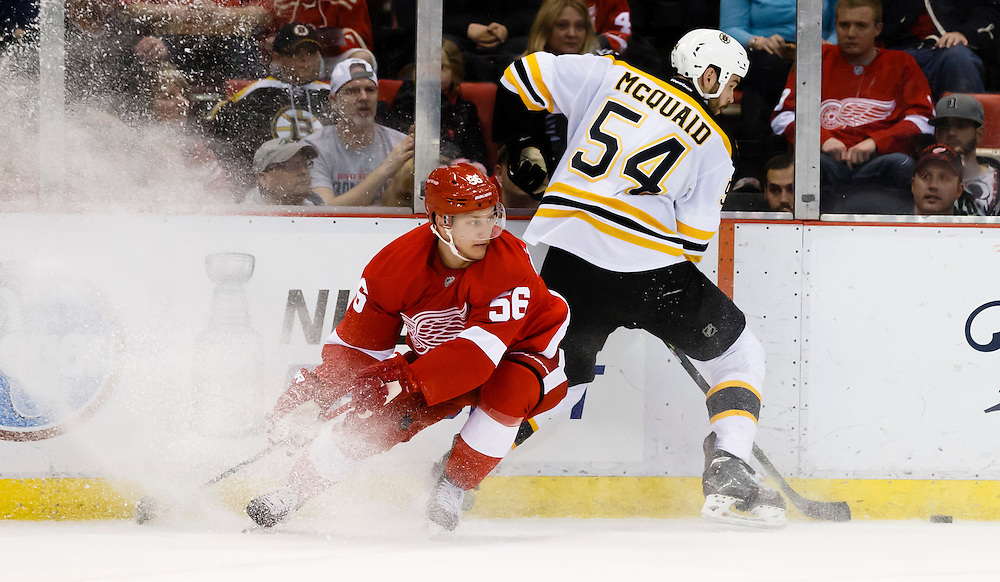 Apr 2, 2015; Detroit, MI, USA; Detroit Red Wings left wing Teemu Pulkkinen (56) and Boston Bruins defenseman Adam McQuaid (54) battle for the puck in the first period at Joe Louis Arena. Mandatory Credit: Rick Osentoski-USA TODAY Sports