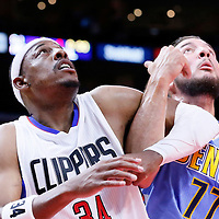 02 October 2015: Denver Nuggets forward Joffrey Lauvergne (77) vies for the rebound with Los Angeles Clippers forward Paul Pierce (34) during the Los Angeles Clippers 103-96 victory over the Denver Nuggets, in a preseason game, at the Staples Center, Los Angeles, California, USA.