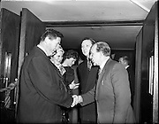 05/02/1960<br /> 02/05/1060<br /> 05 February 1960 <br /> Premiere of Mise Eire at the Regal Cinema, Dublin.  Image shows on right Sean Ó Siothchain, Assistant Secretary of the GAA and Trustee of Gael Linn, and Riobard Mac Góráin of Gael Linn welcoming Mr Kevin Boland TD, Minister of Defence to the film premiere.