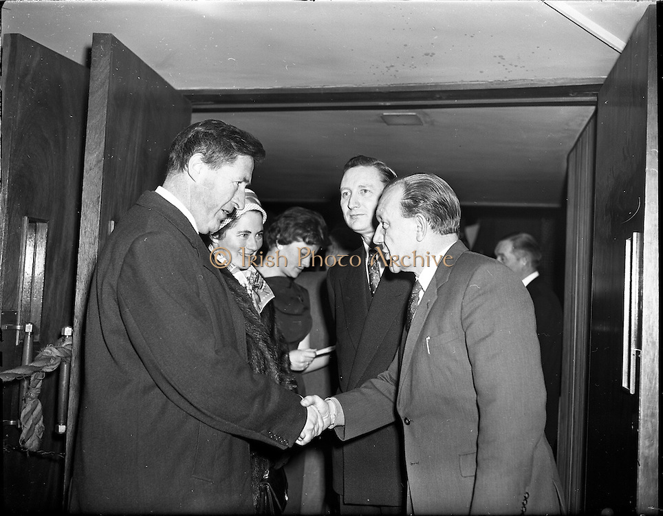 05/02/1960<br /> 02/05/1060<br /> 05 February 1960 <br /> Premiere of Mise Eire at the Regal Cinema, Dublin.  Image shows on right Sean &Oacute; Siothchain, Assistant Secretary of the GAA and Trustee of Gael Linn, and Riobard Mac G&oacute;r&aacute;in of Gael Linn welcoming Mr Kevin Boland TD, Minister of Defence to the film premiere.