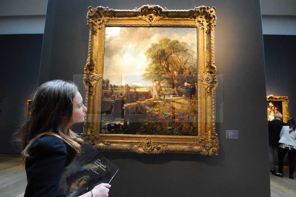 © Licensed to London News Pictures. 06/06/2012. London,Britain. A Christie's employee looking at John Constable's 'The Lock'  is estimated to sell for between £20 million and £25 million. The sale is part of the Old Master & British Paintings Evening Auction at Christie's. Photo credit : Thomas Campean/LNP..