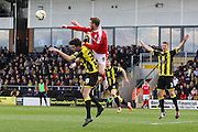 Barnsley forward Sam Winnall and Burton Albion defender Tom Flanagan challenge for the ball in the air during the Sky Bet League 1 match between Burton Albion and Barnsley at the Pirelli Stadium, Burton upon Trent, England on 16 April 2016. Photo by Aaron  Lupton.