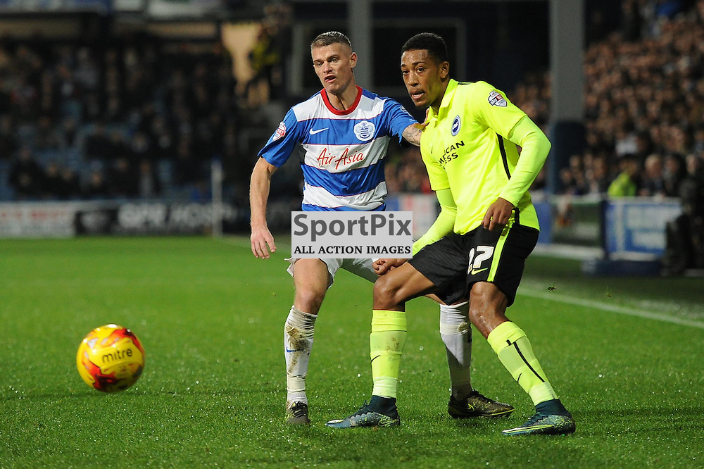 QPRs Paul Konchesky and Brightons Rajiv Van La Parra in action during the Queens Park Rangers v Brighton & Hove Albion game in the  Sky Bet Championship on Tuesday 15th Decemeber 2015 at Loftus Road.