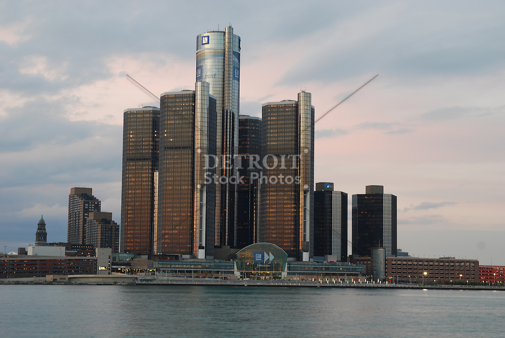 The buildings of Detroit, MI reflecting into the Detroit River at dusk. The Detroit waterfront and skyline.