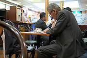 senior businessman in a coffee bar Tokyo Japan