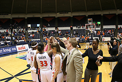 The 2005-2006 Women's Basketball Team celebrates a second round Women's NIT win over Miami.  The Wahoos beat the Hurricanes 83-72 at University Hall.