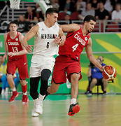 14th April 2018, Gold Coast Convention and Exhibition Centre, Gold Coast, Australia; Commonwealth Games day 10, Basketball, Mens semi final, New Zealand versus Canada; Ammanuel Diressa of Canada dribbles the ball around Jarrod Kenny of New Zealand