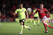 Walsall defender, Matt Preston abd Brighton striker, Sam Baldock in a foot race during the Capital One Cup match between Walsall and Brighton and Hove Albion at the Banks's Stadium, Walsall, England on 25 August 2015.