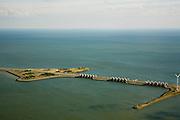 Nederland, Noord-Holland, Den Oever, 14-07-2008; Afsluitdijk, waterkering tussen Waddenzee en IJsselmeer (rechts en onder, voorheen Zuiderzee). Aanleg van de dijk vormde onderdeel Zuiderzeewerken, initiatief van ingenieur Cornelis Lely. In de dijk de Stevinsluizen, spuisluizen of uitwaterende sluizen. Het 'eiland' heet Robbenplaat.<br /> The IJsselmeer Dam or Enclosure Dam, dike between the provinces Noord-Holland and Friesland, left Wadden sea, below and right former Zuyder Zee (now inner sea/lake). In the foreground locks for sluicing surplus water. luchtfoto (toeslag), aerial photo (additional fee required)<br /> foto/photo Siebe Swart