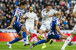 14.02.2015, Estadio Santiago Bernabeu, Madrid, ESP, Primera Division, Real Madrid vs Deportivo La Coruna, 23. Runde, im Bild Real Madrid&acute;s Cristiano Ronaldo and Deportivo de la Coruna's Celso Borges and Manuel Pablo // during the Spanish Primera Division 23rd round match between Real Madrid vs Deportivo La Coruna at the Estadio Santiago Bernabeu in Madrid, Spain on 2015/02/14. EXPA Pictures &copy; 2015, PhotoCredit: EXPA/ Alterphotos/ Luis Fernandez<br /> <br /> *****ATTENTION - OUT of ESP, SUI*****