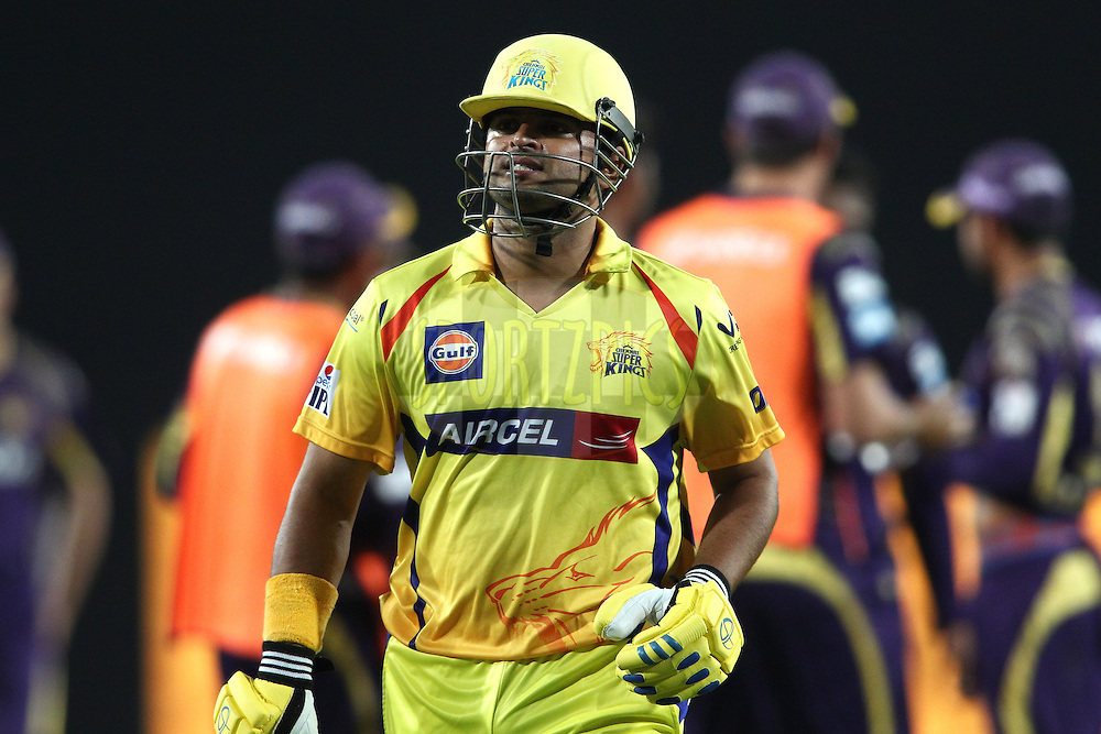 Suresh Raina of The Chennai Super Kings walks back to the dug out after losing his wicket during match 21 of the Pepsi Indian Premier League Season 2014 between the Chennai Superkings and the Kolkata Knight Riders  held at the JSCA International Cricket Stadium, Ranch, India on the 2nd May  2014<br /> <br /> Photo by Shaun Roy / IPL / SPORTZPICS<br /> <br /> <br /> <br /> Image use subject to terms and conditions which can be found here:  http://sportzpics.photoshelter.com/gallery/Pepsi-IPL-Image-terms-and-conditions/G00004VW1IVJ.gB0/C0000TScjhBM6ikg