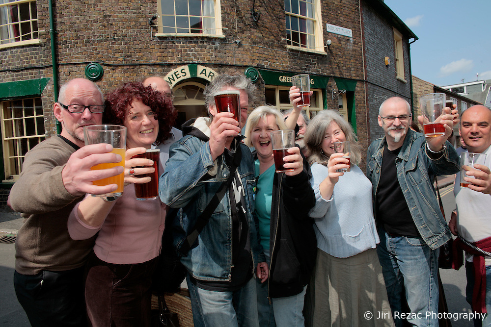 UK ENGLAND LEWES 20APR07 - Patrons celebrate their victory at the Lewes Arms, a local pub owned by Norfolk brewery Greene King. Local residents today won an unusual victory by forcing the pub's owners to reintroduce Harvey's Bitter beer, a local beer brand that was withdrawn from sale four months ago. The Lewes Arms, a lively pivot point for community life, became the target of a determined campaign by locals who organised a boycott and picket lines to get their favourite beer reinstated by Greene King...jre/Photo by Jiri Rezac..© Jiri Rezac 2007..Contact: +44 (0) 7050 110 417.Mobile:  +44 (0) 7801 337 683.Office:  +44 (0) 20 8968 9635..Email:   jiri@jirirezac.com.Web:    www.jirirezac.com..© All images Jiri Rezac 2007 - All rights reserved.