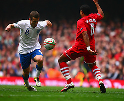 26.03.2011, Millenium Stadium, Cardiff, ENG, EURO 2012 Qualifikation, England vs Wales, im Bild Action with Jack Wilshere of England  and Ashley Williams of Wales      during Wales vs England at the Millenium Stadium in Cardiff for the Euro 2012 qualification, group G  on 26/03/2011. EXPA Pictures © 2011, PhotoCredit: EXPA/ IPS/ Marcello Pozzetti +++++ ATTENTION - OUT OF ENGLAND/UK and FRANCE/FR +++++