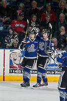 KELOWNA, CANADA - MARCH 11: Tyler Soy #17 and Jack Walker #9 of Victoria Royals celebrate a goal against the Kelowna Rockets on March 11, 2015 at Prospera Place in Kelowna, British Columbia, Canada.  (Photo by Marissa Baecker/Shoot the Breeze)  *** Local Caption *** Tyler Soy; Jack Walker;