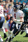 JACKSONVILLE, FL - DECEMBER 12:  Quarterback Chad Hutchinson #9 of the Chicago Bears runs from the defense in vain, as the Jacksonville Jaguars recorded five quarterback sacks on December 12, 2004 at Alltel Stadium in Jacksonville, Florida. The Jags defeated the Bears 22-3. ©Paul Anthony Spinelli *** Local Caption *** Chad Hutchinson