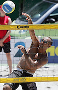 Craig Seuseu (NZ) smashes the ball over at the NZ Beach Volleyball Open at Stanley St, Auckland, New Zealand on Friday 20 January, 2006. Photo: Hannah Johnston/PHOTOSPORT<br />
