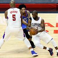 16 January 2017: LA Clippers guard Raymond Felton (2) drives past Oklahoma City Thunder guard Cameron Payne (22) on a screen set by LA Clippers center Marreese Speights (5) during the LA Clippers 120-98 victory over the Orlando Magic, at the Staples Center, Los Angeles, California, USA.