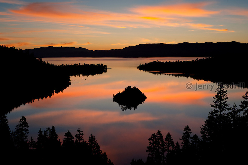 Dawn at Emerald Bay, Lake Tahoe. This large freshwater lake in the Sierra Nevada mountain range lies on the California/Nevada Border. At a surface elevation of 6,225 ft Lake Tahoe is the largest alpine lake in North America with a depth of 1,645 ft.