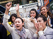 29 NOVEMBER 2013 - BANGKOK, THAILAND: Bank workers cheer anti-government protestors in Bangkok. Although the government has a popular mandate, most of its supporters are from the rural northeast part of Thailand. Most members of Bangkok's middle class oppose the government. Several thousand Thai anti-government protestors marched on the US Embassy in Bangkok. They blew whistles and asked the US to honor their efforts to unseat the elected government of Yingluck Shinawatra. The anti-government protestors marched through several parts of Bangkok Friday paralyzing traffic but no clashes were reported, even after a group protestors tried to occupy Army headquarters.         PHOTO BY JACK KURTZ