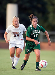 Loyola Greyhounds midfielder Kelly Farrell (17) is defended by Virginia Cavaliers defender Colleen Flanagan (24).  The #6 Virginia Cavaliers defeated the Loyola College Greyhounds 4-0 in a NCAA Women's Soccer game held at Klockner Stadium on the Grounds of the University of Virginia in Charlottesville, VA on August 22, 2008.
