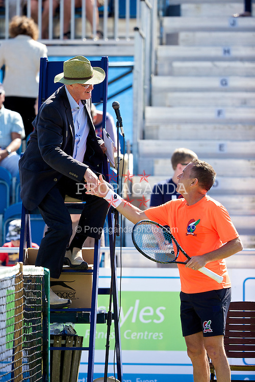 LIVERPOOL, ENGLAND - Saturday, June 21, 2014: Mikael Pernfors (SWE) shakes hands with the umpire during Day Three of the Liverpool Hope University International Tennis Tournament at Liverpool Cricket Club. (Pic by David Rawcliffe/Propaganda)