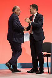 © Licensed to London News Pictures . 30/09/2015 . Brighton , UK . CHARLES FALCONER ( Baron Falconer of Thoroton ) and ANDY BURNHAM shake hands after Falconer's speech . The 2015 Labour Party Conference . Photo credit : Joel Goodman/LNP