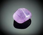 Cutout of a phantom amethyst gemstone on black background