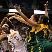 Chiney Ogwumike, (left), Connecticut Sun, is blocked by Jenna O'Hea, (centre), and Camille Little, Seattle Storm, during the Connecticut Sun Vs Seattle Storm WNBA regular season game at Mohegan Sun Arena, Uncasville, Connecticut, USA. 23rd May 2014. Photo Tim Clayton