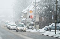 © Licensed to London News Pictures. 27/02/2020. Stokenchurch, UK. Traffic battles through Heavy snowfall  in Stokenchurch, Buckinghamshire, England, as the south east is hit by snow for the first time in 2020. Large parts of the UK are experiencing heavy flooding with flood barriers being breached in worst hit areas. Photo credit: Ben Cawthra/LNP