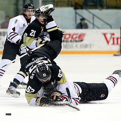 NEWMARKET, ON - Feb 20 : Ontario Junior Hockey League Game Action between the Trenton Golden Hawks and the Newmarket Hurricanes, Jordan Oshowy  #2 of the Newmarket Hurricanes Hockey Club makes the hit on Zach de Concilys #53 of the Trenton Golden Hawks Hockey Club.<br /> (Photo by Brian Watts / OJHL Images)