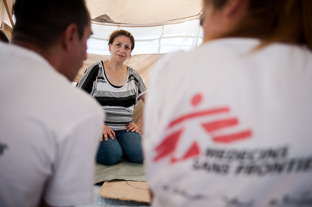 MSF psychiatrist Lena Zachou is counselling 40 year old Aysha from Aleppo with the help of MSF Arabic translator Rashid Bech at her tent in Kara Tepe camp