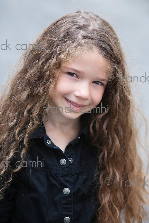 caucasian little girl portrait  smiling cheerful isolated studio on grey background