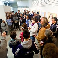 041113       Brian Leddy<br /> A crowd gathers inside Art123 during the March ArtsCrawl.
