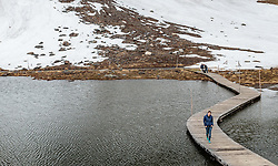 THEMENBILD - ein Frau überquert auf einem Steg die Fuscher Lacke. Die Grossglockner Hochalpenstrasse verbindet die beiden Bundeslaender Salzburg und Kaernten mit einer Laenge von 48 Kilometer und ist als Erlebnisstrasse vorrangig von touristischer Bedeutung, aufgenommen am 5. Juni 2017, Fusch a. d. Glocknerstrasse, Oesterreich // a woman on a footbridge crossing the Fuscher Lacke. The Grossglockner High Alpine Road connects the two provinces of Salzburg and Carinthia with a length of 48 km and is as an adventure road priority of tourist interest at Fusch a. d. Glocknerstrasse, Austria on 2017/06/05. EXPA Pictures © 2017, PhotoCredit: EXPA/ JFK
