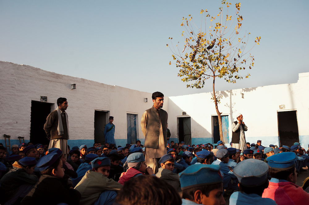 Pakistan/ Afghan refugees/ Students attend a morning assembly at their school in the Khazana refugee camp, Peshawar. The camp was established when refugees flooded across the border from Afghanistan during the 1979 Soviet occupation. The refugee camp has a population of 2500 and during the 2010 floods that swept through Pakistan most families were affected. The majority of people rebuilt their houses after the floods with their own resources. The most vulnerable also received support from UNHCR for reconstruction. UNHCR/Sam Phelps/ November 2011.