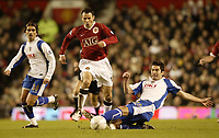 Photo: Aidan Ellis.<br /> Manchester United v Portsmouth. The FA Cup. 27/01/2007.<br /> United's Ryan Giggs gets away from the challenge of Pompey's Richard Hughes.