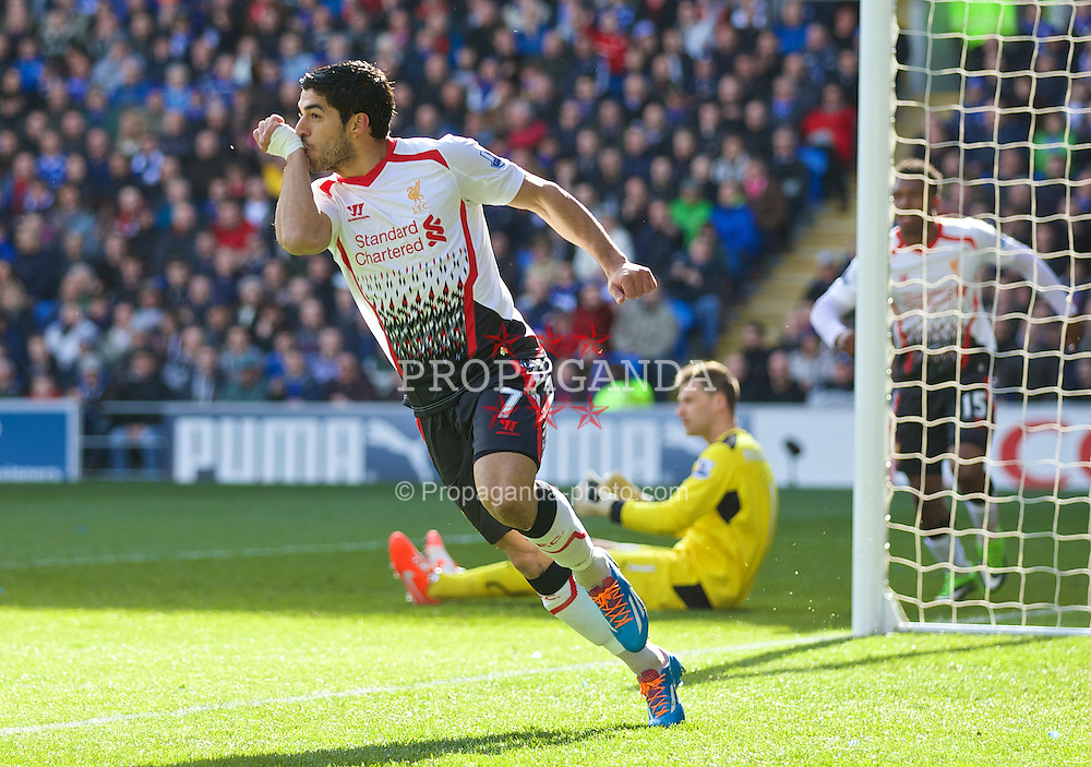 CARDIFF, WALES - Saturday, March 22, 2014: Liverpool's Luis Suarez celebrates scoring the first goal against Cardiff City, the first of his hat-trick, during the Premiership match at the Cardiff City Stadium. (Pic by David Rawcliffe/Propaganda)