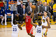 Houston Rockets guard James Harden (13) takes the ball to the basket against the Golden State Warriors during Game 3 of the Western Conference Finals at Oracle Arena in Oakland, Calif., on May 20, 2018. (Stan Olszewski/Special to S.F. Examiner)