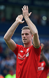 WEST BROMWICH, ENGLAND - Sunday, May 15, 2016: Liverpool's captain Jordan Henderson applauds the supporters after the 1-1 draw against West Bromwich Albion during the final Premier League match of the season at the Hawthorns. (Pic by David Rawcliffe/Propaganda)