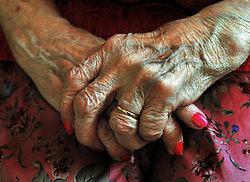 File photo dated 05/12/08 of the hands of an elderly woman. Retired households handed over £7,400 typically in tax last year - the equivalent of nearly a third (30\%) of their annual income, according to analysis.