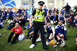 10th June 2017 - 2018 FIFA World Cup Qualifying (Group F) - Scotland v England - A police officer walks amongst the Scotland fans - Photo: Simon Stacpoole / Offside.