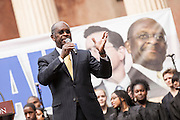 Former Republican presidential candidate Herman Cain during a call with Comedian Stephen Colbert at the College of Charleston on January 20, 2012 in Charleston, South Carolina. Colbert held the event with Cain, titled Rock Me Like a Herman Cain South Cain-olina Primary Rally, as part of his pseudo-run for president of The United States of South Carolina.