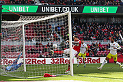 Middlesbrough defender Aden Flint (24) clears the ball off the line as Hull City players appeal for a goal during the EFL Sky Bet Championship match between Middlesbrough and Hull City at the Riverside Stadium, Middlesbrough, England on 13 April 2019.