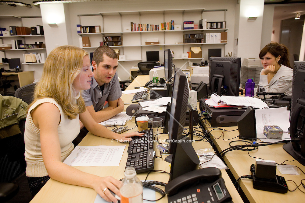 "Producers L to R: Kate Susman, Jared Heinke, Becky Lewis review websites and scripts prior to taping the Friday, Oct. 20 episode of Yahoo!'s ""The 9"" in their New York studio."