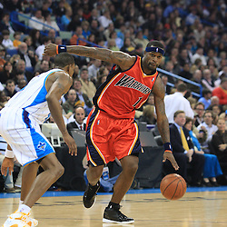 30 January 2009:  Golden State Warriors forward Stephen Jackson (1) is defended by New Orleans Hornets guard Rasual Butler (45) during a 91-87 loss by the New Orleans Hornets to Golden State Warriors at the New Orleans Arena in New Orleans, LA.