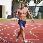 JANUARY 24, 2019--MIAMI, FLORIDA,<br /> Kevin Mayer, left, a world record holder in decathlon from France, shoots video of Benjamin Hougardy, an athlete from Belgium, during a work out in a track and field facility on the University of Miami.<br /> (Photo by Angel Valentin)