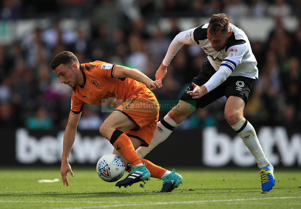 Derby County's Richard Keogh and Wolverhampton Wanderers' Dioga Jota battle for the ball
