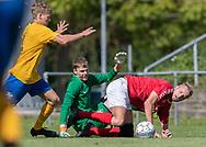 Magnus Pedersen og Kasper Pedersen (Ølstykke FC) redder chance fra Rasmus Larsen (Ejby) under kampen i Serie 2 mellem Ølstykke FC og Ejby IF den 7. september 2019 på Ølstykke Stadion. Foto: Claus Birch.