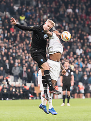 (L-R) Franz Brorsson of Malmo FF, Cyle Christopher Larin of Besiktas JK during the UEFA Europa League group I match between between Besiktas AS and Malmo FF at the Besiktas Park on December 13, 2018 in Istanbul, Turkey