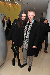 JOHN SIMM and KATE MAGOWAN at the pre party for the English National Ballet's Christmas performance of The Nutcracker held at the St.Martin's Lane Hotel, St.Martin's Lane, London on 14th December 2011.